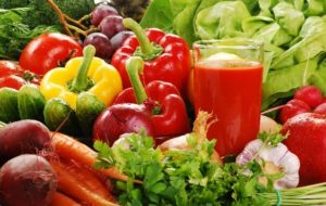 Collection of fresh vegetables and a glass of tomato juice | Cooking nutritious meals often challenges seniors living at home alone. | Neighborly Home Care