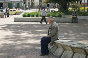 Senior man sitting on park bench | exploring dementia | Neighborly Home Care