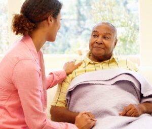 Elderly man with caregiver | exploring dementia | Neighborly Home Care