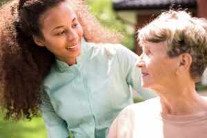 Senior woman with caregiver | exploring dementia | Neighborly Home Care